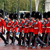 Another formation of Queen's Guards enters Buckingham Palace.