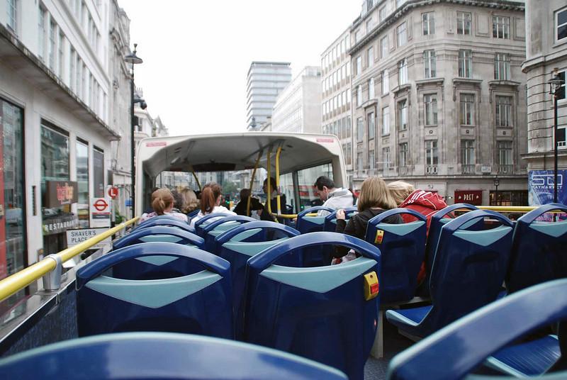 On the double-decker tour bus.