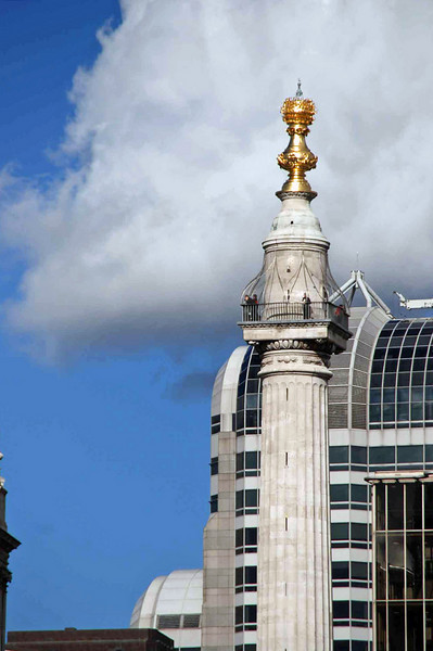 The Monument to the Great Fire of London is visible from the Thames.