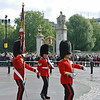 The Queen's Guards carrying their standard flag.
