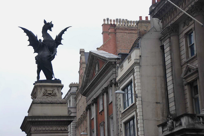 A statue of a griffin (a winged lion with a head of an eagle or dragon) marks The Temple Bar, the westernmost gate into the old city of London.