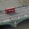 A double decker bus crosses Westminster Bridge.