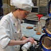 An artisan applies the finishing touches to a chocolate slipper at Demel's Chocolate.