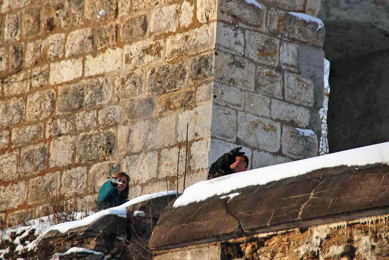 Janet Gegan and Brian Stephenson (throwing a snowball at us) from up high on the castle walls.
