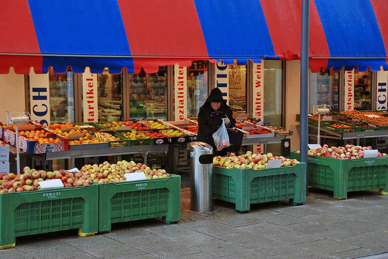 A local resident shops at the food market.