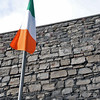 The Irish flag waves over the prison yard where the martyrs of the Irish Revolution were executed.