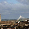 An old church and a modern bridge in a city passed on the way to Belfast.