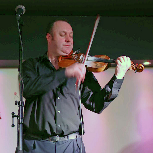 The Irish fiddler in the live music show.