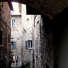 Narrow walkways of the main center of Assisi .