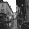 Center street, Assisi, black and white in the rain.