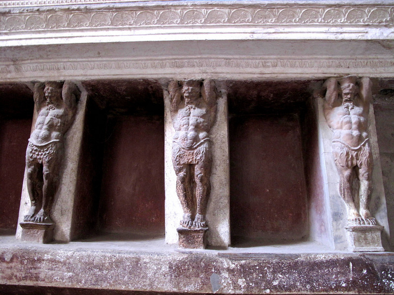 Roman bath statuary...showing detail and could be Hercules holding up the building with his evidenced muscles.