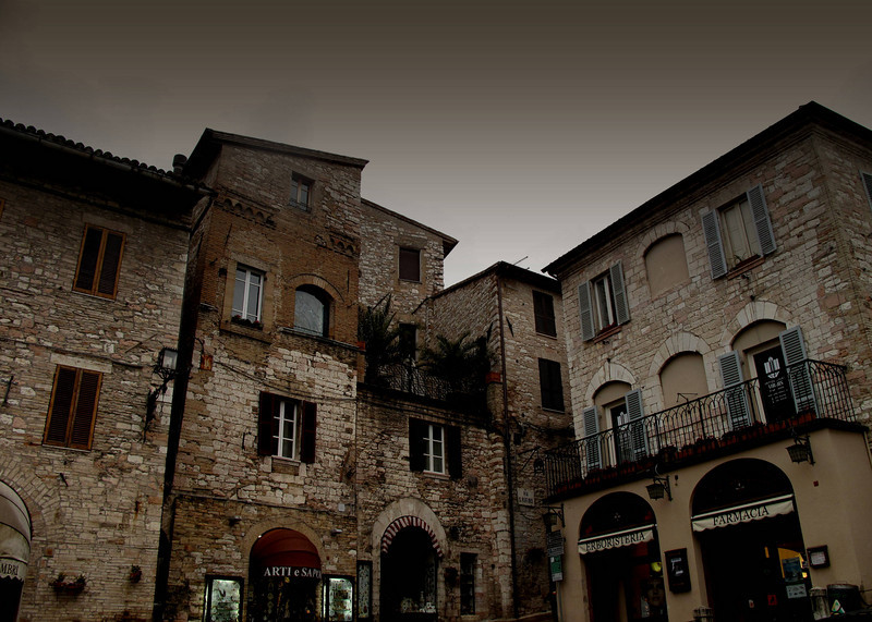 Dramatic view of the buildings of Assisi in the twilight.