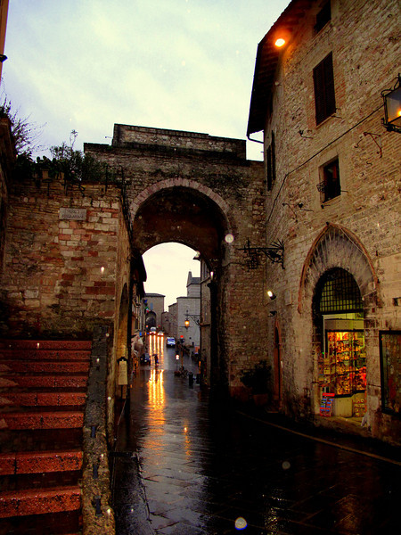 City gate of Assisi, Protected by it's location, high up on the hill overlooking the valley below. The narrow, ancient streets reflect the lives of the people.
