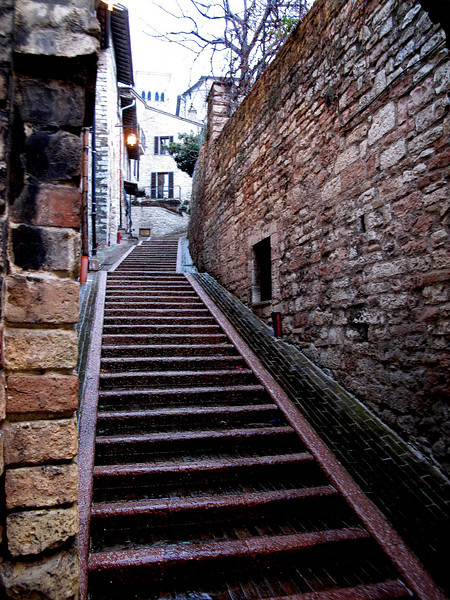 Stairs of Assisi<br /> Assisi is built on a hill and the stairs are like rabbit warrens, up, down, along narrow streets, Great views!