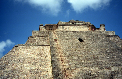 UXMAL, MEXICO - The massive scale of a Maya pyramid becomes most apparent when one stands at the base and looks upward.