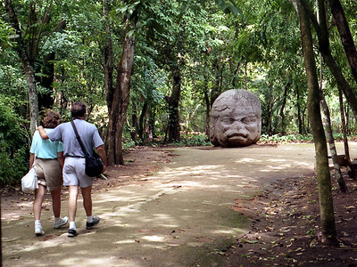 VILLAHERMOSA, MEXICO - We began at the Museum Park of La Venta where the artifacts of the Olmecs - a predecessor culture to the Maya - were on display.  Here our traveling companions take a stroll through the park, approaching one of the most intriquing of pre-Mayan stone heads carved by the Olmecs.