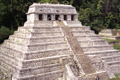 PALENQUE, MEXICO - In the heart of Palenque, dominating the site, stands the Temple of Inscriptions.  The central stairway leads to the top sanctuary composed of five bays.