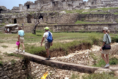 PALENQUE, MEXICO - In all too short of a time, we had to leave Palenque, descending from the Temple of the Cross and crossing this narrow foot bridge over an aqueduct the Mayans had built 1400 years before.