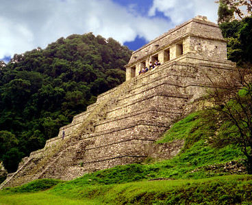 PALENQUE, MEXICO - By the time we took one last look, the fog has dissipated, the clouds had parted, and the sun had emerged.  And the Temple of the Inscriptions shown in its full brillance.