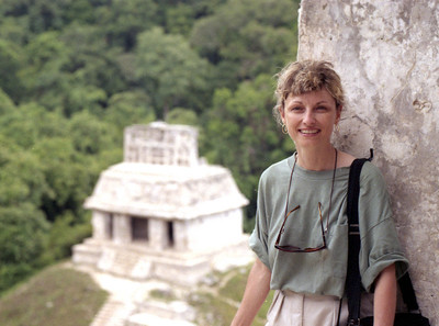 PALENQUE, MEXICO - Jeanne stands in the Temple of the Foliated Cross overlooking the Temple of the Cross.