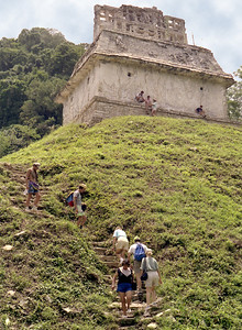 PALENQUE, MEXICO - On our first foray into the ancient world of the Maya, we learned that if you want to see everything, you have to climb.  Here we are climbing to the Temple of the Cross.  Quite likely we are walking over the buried stone ruins of a Mayan pyramid.