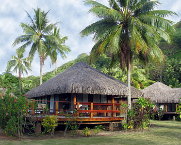 "HUAHINE, POLYNESIA - ""Rooms"" at the Te Tiare Resort are these thatched bungalows scattered around manicured grounds.  This was our's."
