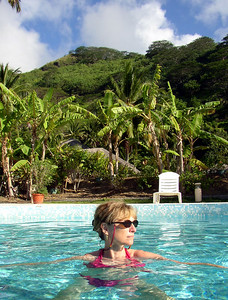HUAHINE, POLYNESIA - Despite the nearby presence of the ocean, Jeanne couldn't resist a quick dip in the palm tree-surrounded pool.