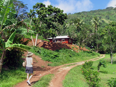 "HUAHINE, POLYNESIA - Huahine is known as ""The Garden Island"" due to its abundance of lush green tropical foliage and wild jungle-like scenery.  After walking through the town of Fare, we found a road to follow into the jungle."