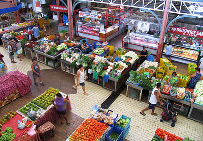 PAPEETE, TAHITI - An astounding - and colorful - array of fruits, vegetables, fish, meat, handicrafts, and other items are sold under the big tin pavilion of Papeete's bustling public market.