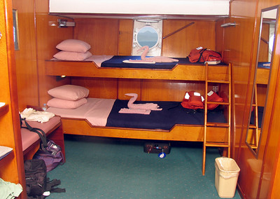 AMAZING GRACE - Like most of the Windjammer fleet, the rooms of the Amazing Grace are not particularly spacious but beautifully paneled in polished teak.  We actually had one of the larger passenger rooms.  Each day the stewards would make our beds and fold the towels in the shape of some animal.