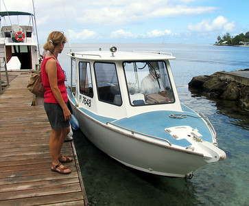 HUAHINE, POLYNESIA - When we returned to Huahine (by airplane) after the Windjammer trip, we were transported to this small dock where this small boat was ready to transport us to our hotel.