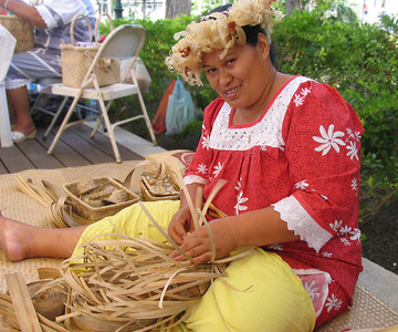PAPEETE, TAHITI - At a local craft center, a Tahitian woman weaves a basket.