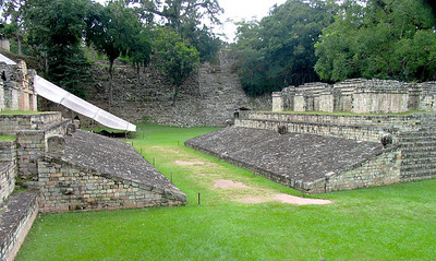 "COPAN, HONDURAS - Virtually every Maya site has the ruins of a ballcourt.  This one is the largest of such courts built in the Maya ""Classic"" period (200 A.D - 900 A.D.).  Here teams of 5 to 7 players would attempt to bounce a rubber ball off, or through, stone carvings set at the tops of the sloping walls.  Many Mayanists believe the ballgame was a religous ritual, and some contend that the losers (or possibly, the winners) were sacrificed."