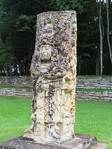 "COPAN, HONDURAS - Another view of Stela H which depicts ""18 Rabbit"" reenacting the ""Creation Dance."" To reinforce his identity, he wears a huge zoomorphic Maize God headdress with the leaves and ear of the plant arching over his head.  ""18 Rabbit"" was the 13th ruler of Copan and certainly its most prolific stelae builder - he was responsible for at least 10 of the site's stelae."