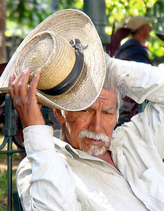 SAN SALVADOR, EL SALVADOR - Some faces just jump out at you. In the park across the street from the Metropolitan Cathedral, this gentleman resting on a bench caught our attention.