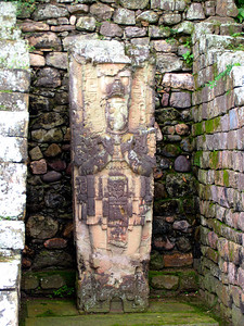 "COPAN, HONDURAS - One of few stelae in the Great Plaza that does NOT depict ""18 Rabbit,"" Stela 1 is set back into a niche.  The figure shown on the stela has been determined to be Smoke Imix God K (or Smoke Jaguar), the 12th ruler of Copán."