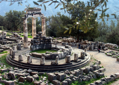 DELPHI, GREECE - In the valley below the main Delphi sanctuary there was another temple, this one dedicated to the goddess Athena.  The purpose of its most prominent feature - the circular tholos - remains a mystery.