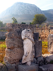 CORINTH, GREECE - Headless statues are tucked in small alcoves and beside stone walls.  We learned that many were made intentionally with interchangeable heads that could be replaced when the city changed its mind on its rulers or heroes.
