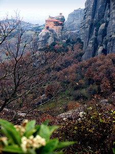 "METEORA, GREECE - ""Meteora"" means ""suspended in air."" Until the 1920s, the only access monks had to these monasteries was a net hitched over a hook and hoisted by rope and a handcranked windlass.  The ropes were replaced only when, according to the monks, ""the Lord let them break."""