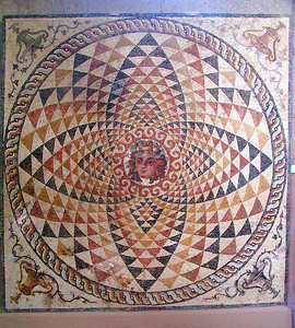 CORINTH, GREECE - Corinth's museum also displayed an incredible mosaic honoring Dionysos - the Greek god of wine and theater.   It once graced the wall of a local Roman villa in the 2nd century A.D.