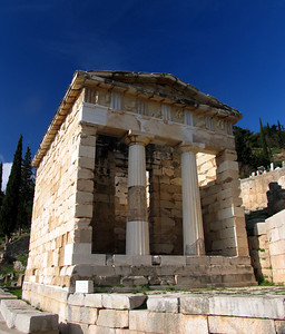 "DELPHI, GREECE - Also along the Sacred Way, pilgrims would pass by numerous ""treasuries"" where the gifts of grateful beneficiaries of the Oracle's guidance would be stored. The most impressive is the Treasury of Athens, built to commemorate the Athenians' victory over the Persians at Marathon."