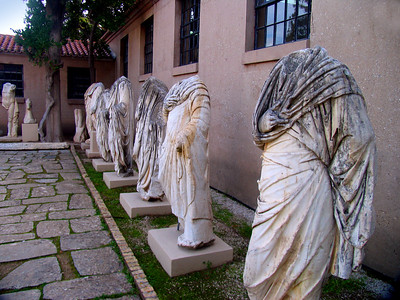 CORINTH, GREECE - Inside the Corinth museum we found more headless statues.  There seemed to be far more stone bodies on display than there were heads.