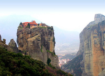 METEORA, GREECE: CLIFFTOP SANCTUARIES IN THE CLOUDS - Continuing our journey northward, we reached the Plain of Thessaly and encountered massive granite pinnacles.  At the top were monasteries, the earliest built in the 14th century by monks seeking refuge from Turkish pirates.  This is the Monastery of the Holy Trinity.