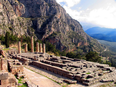 DELPHI, GREECE - Central among the Delphi ruins is the Temple of Apollo, first built around the 7th century B.C., rebuilt after a fire in the 6th century B.C., destroyed in 373 B.C. by an earthquake, and rebuilt for a third time in 330 B.C.  Today only the foundation and six doric columns remain.