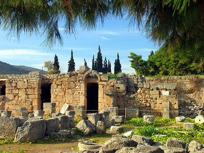 CORINTH, GREECE - Below the Temple of Apollo is the Corinth agora - the marketplace.  These are the remains of shops at the western end.