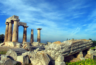 CORINTH, GREECE - Like many ancient Greek ruins, what remains of temple columns rise above vast amounts of fallen stonework.