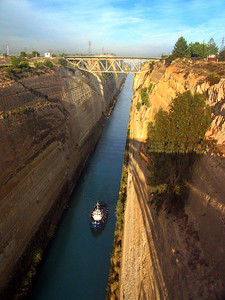 THE CORINTH (GREECE) CANAL - Corinth sits at the neck of a narrow isthmus between the Ionian and Aegean Seas.  A canal to link the two seas was first proposed in the 6th century B.C., but nothing came of it until the emperor Nero struck the first blow with a golden pickaxe in 67 A.D.  But it took 1826 years before technology and a French engineering company could complete the channel. Today it is too narrow for most merchant vessels.