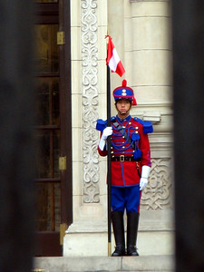 LIMA, PERU - Today, the Government Palace is guarded by the Hussares de Junin regiment dressed in the ceremonial uniforms and ornamental helmets of the early 19th century.
