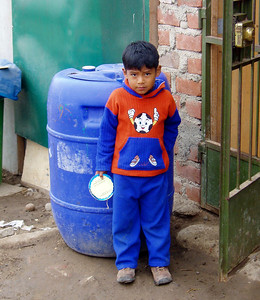 LIMA, PERU - Today, one out of every 3 of Peru's 27 million people live in and around Lima -- and all too many are in these types of desert settlements, where a water barrel like the one behind this little boy is filled three times a week to provide his family with their only source of potable water.
