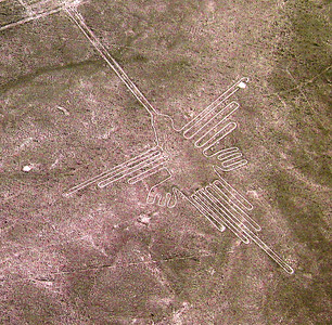 NAZCA LINES - The Nazcas created the lines by removing iron oxide-coated pebbles which cover the desert surface.  When the gravel was removed, the light-colored earth underneath was revealed.  Each line is as much as 4 to 6 feet wide.  This is the Nazcas' depiction of a hummingbird.